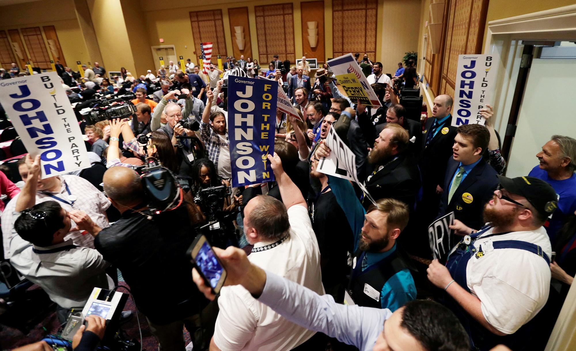 Attendees at the Libertarian Party National Convention yell for their candidates at the Rosen Center in Orlando, Fla., on May 29. (Photo: Kevin Kolczynski/Reuters)