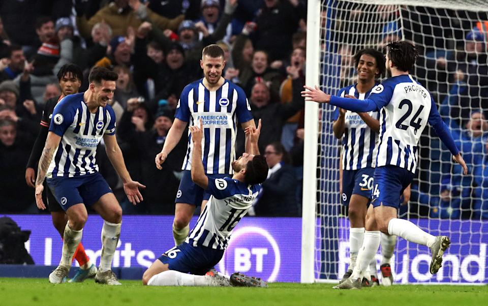 Alireza Jahanbakhsh, centre, was able to celebrate a stunning goal as Brighton drew with Chelsea (Gareth Fuller/PA)