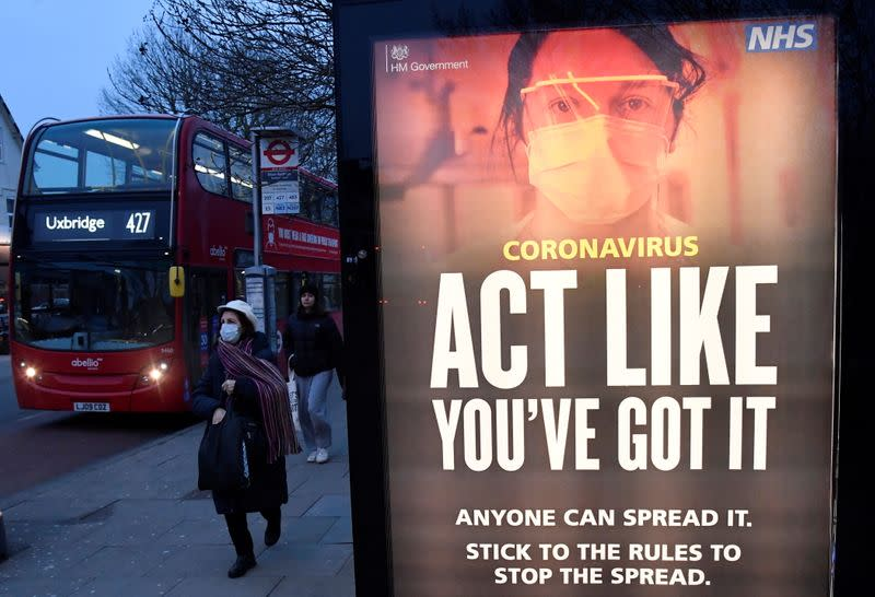 A public health information message is seen at a bus stop in West Ealing , London