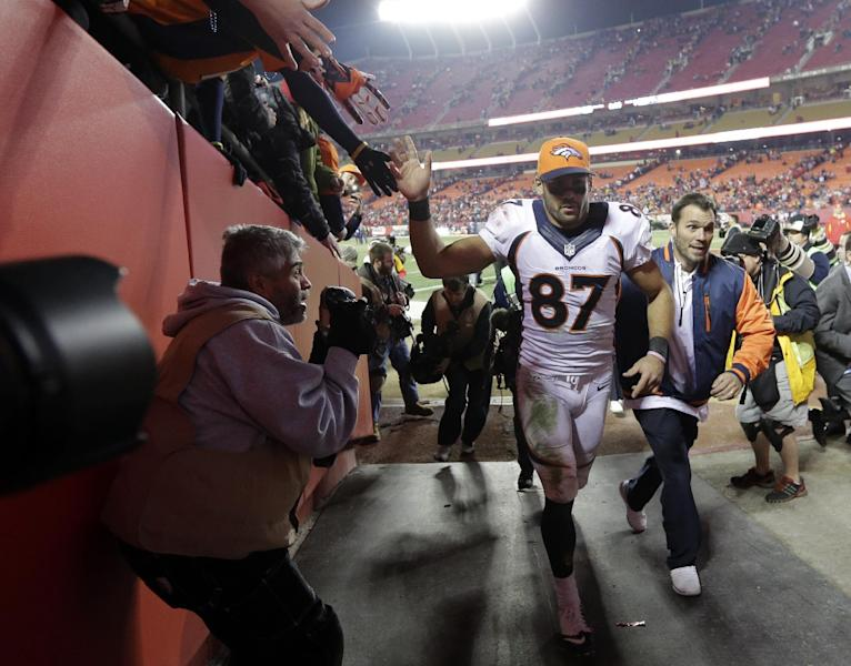 Denver Broncos wide receiver Eric Decker (87) acknowledges the fans as he leaves the field after an NFL football game, Sunday, Dec. 1, 2013, in Kansas City, Mo. The Broncos won 35-28. (AP Photo/Charlie Riedel)