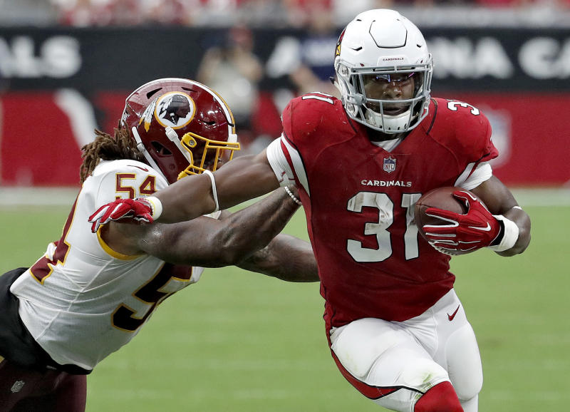 FILE - In this Sept. 9, 2018, file photo, Arizona Cardinals running back David Johnson (31) is hit by Washington Redskins linebacker Mason Foster (54) during the second half of an NFL football game, in Glendale, Ariz. The 0-2 Cardinals face the Chicago Bears on Sunday.(AP Photo/Rick Scuteri, File)