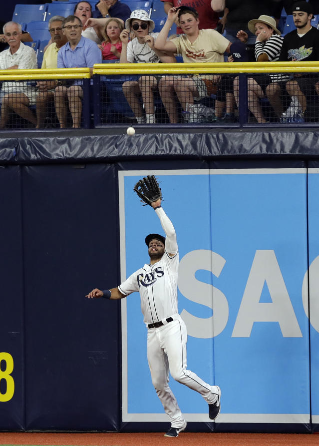 Tampa Bay Rays center fielder Kevin Kiermaier makes the catch on a flyout by Baltimore Orioles' Trey Mancini during the sixth inning of a baseball game Wednesday, April 17, 2019, in St. Petersburg, Fla. (AP Photo/Chris O'Meara)