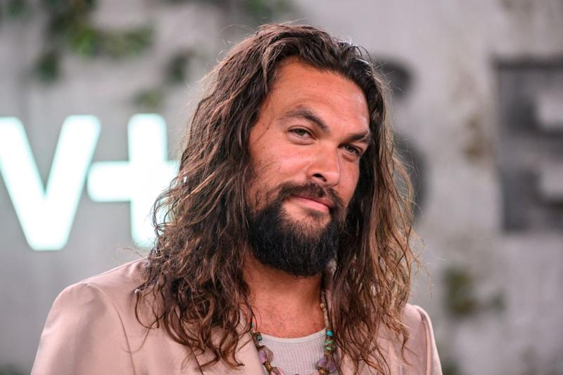 Jason Momoa was criticized on social media for posting a photo of himself with Mel Gibson. (Photo: NICK AGRO/AFP via Getty Images)