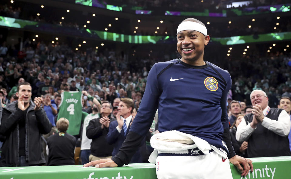 Denver Nuggets guard Isaiah Thomas smiles as his acknowledged by fans during a video tribute during a break the first quarter of an NBA basketball game against the Boston Celtics in Boston, Monday, March 18, 2019. Thomas returned to play in his first game after being traded in 2017 for Kyrie Irving. (AP Photo/Charles Krupa)