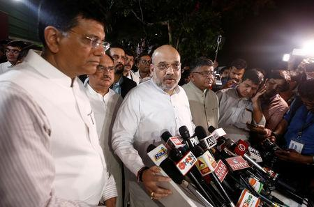 Amit Shah, president of India's ruling Bharatiya Janata Party (BJP) addresses the media outside the residence of the country's former Prime Minister Atal Bihari Vajpayee in New Delhi, India, August 16, 2018. REUTERS/Adnan Abidi