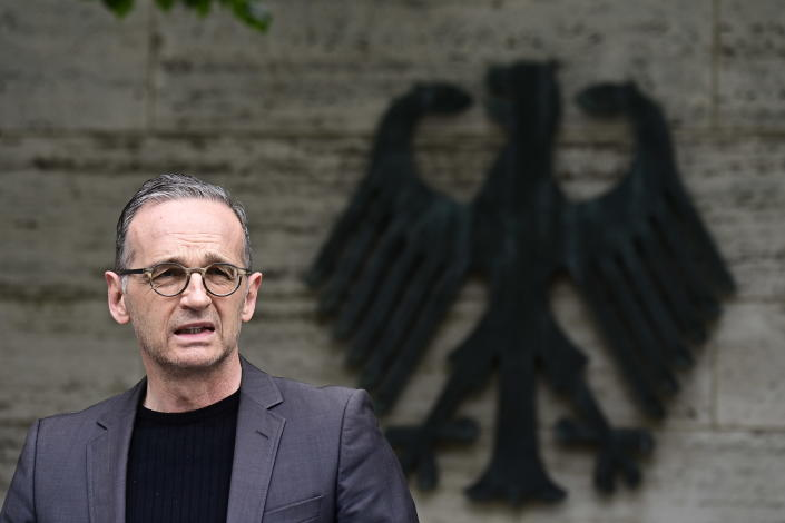 German Foreign Minister Heiko Maas addresses the media during a statement at the Foreign Ministry in Berlin, Germany, Friday, May 28, 2021. Germany has reached an agreement with Namibia that will see it officially recognize as genocide the colonial-era killings of tens of thousands of people and commit to spending a total of 1.1 billion euros ($1.3 billion), largely on development projects. (Tobias Schwarz/Pool Photo via AP)