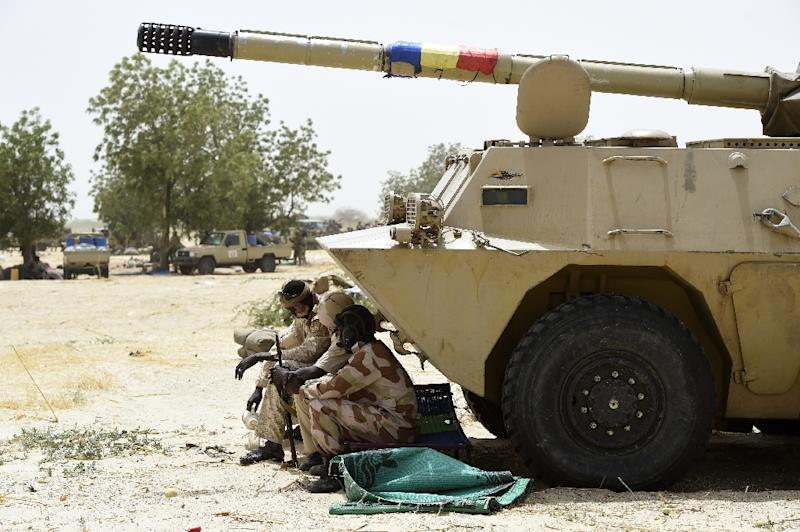 Chadian soldiers rest in the shade of their armoured vehicle near Malam Fatori in northeast Nigeria on April 3, 2015, after the town in was retaken from Boko Haram by troops from Chad and Niger (AFP Photo/Philippe Desmazes)
