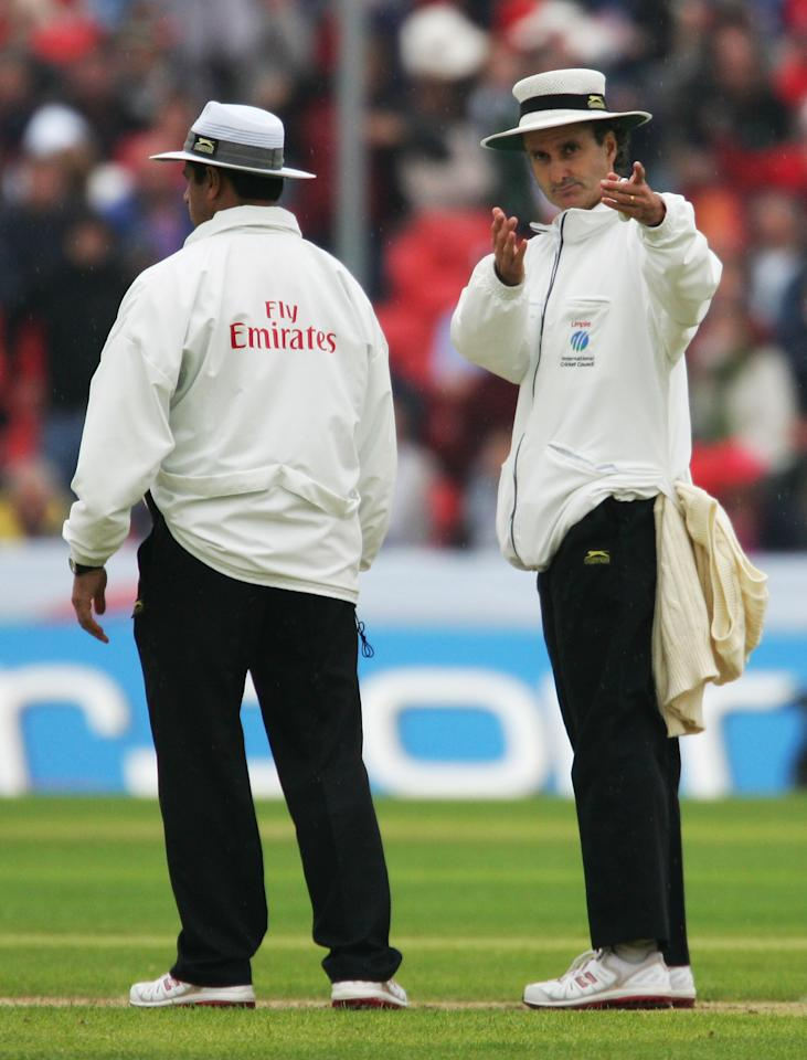 CHESTER-LE-STREET, UNITED KINGDOM - JUNE 16: Umpire Billy Bowden (R) signals to the players to leave the field after bad light stopped play during day two of the Fourth Test match between England and the West Indies at the Riverside Ground on June 16, 2007 in Chester-le-Street, Durham, England.  (Photo by Richard Heathcote/Getty Images)