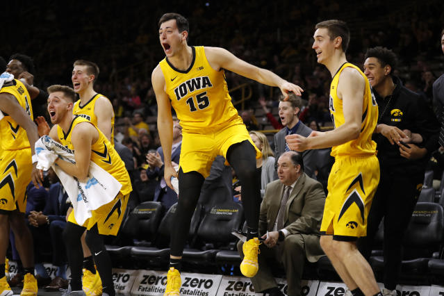 Iowa forward Ryan Kriener (15) celebrates with teammates on the bench during the second half of an NCAA college basketball game against Savannah State, Saturday, Dec. 22, 2018, in Iowa City, Iowa. Iowa won 110-64. (AP Photo/Charlie Neibergall)