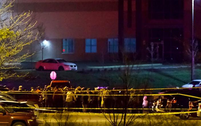 People stand outside a FedEx facility near Indianapolis International Airport after a shooting with multiple victims - Mykal McEldowney/The Indianapolis Star