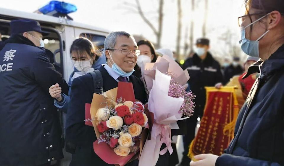 Supporters give Zhou Ze flowers after the hearing in Beijing. Photo: Handout