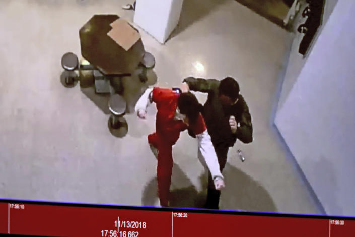 A November 2018 video is shown in court of Parkland school shooter Nikolas Cruz in an altercation with Broward jail guard Sgt. Ray Beltran during a Cruz's pre-trial hearing at the Broward County Courthouse in Fort Lauderdale, Fla., Wednesday, July 14, 2021, on four criminal counts stemming from his alleged attack. Cruz is accused of punching Sgt. Ray Beltran, wrestling him to the ground and taking his stun gun. (Amy Beth Bennett/South Florida Sun-Sentinel via AP, Pool)