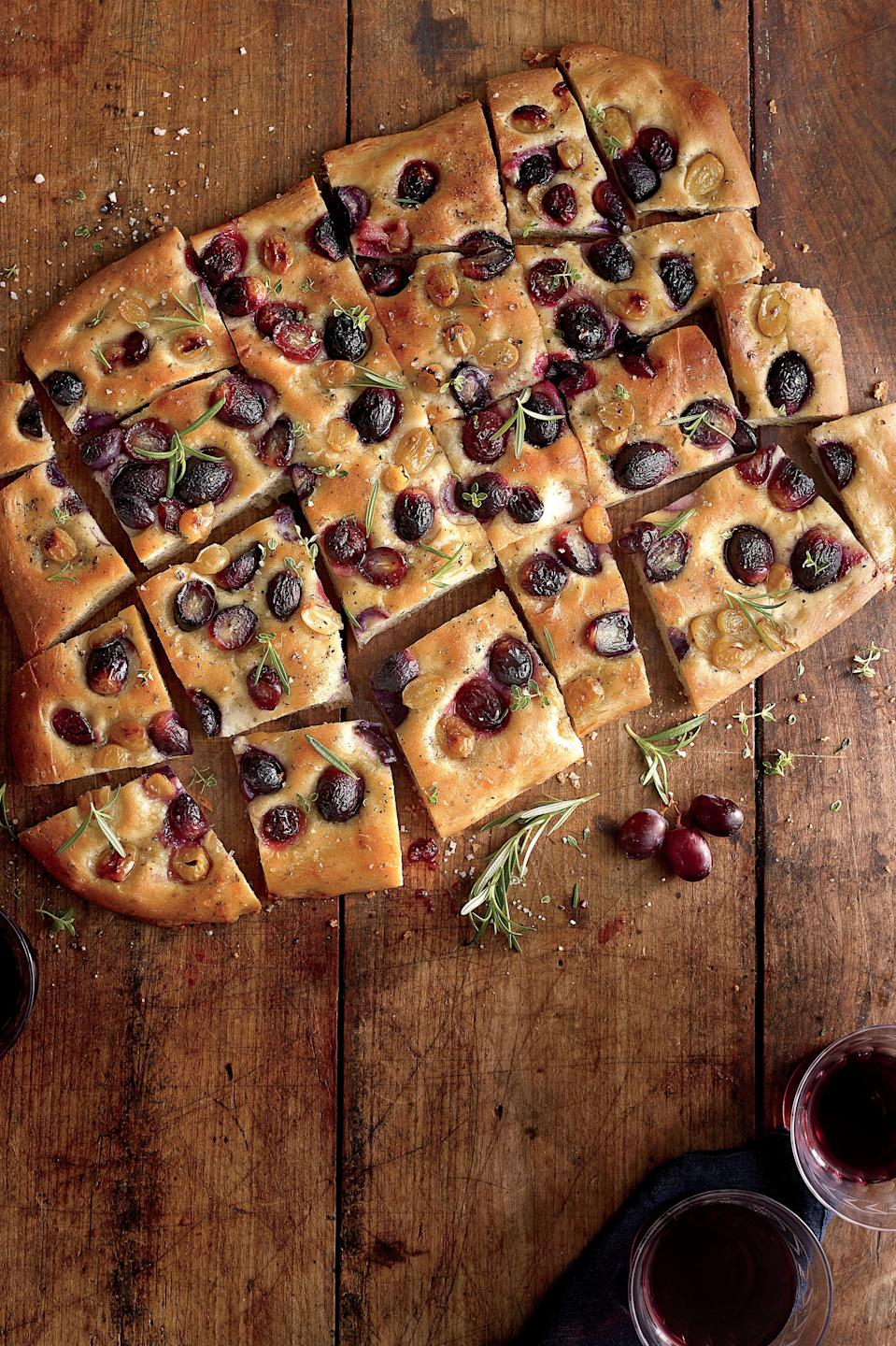 """<p><strong>Recipe: <a href=""""http://www.myrecipes.com/recipe/grape-focaccia-50400000137093/"""" rel=""""nofollow noopener"""" target=""""_blank"""" data-ylk=""""slk:Grape Focaccia"""" class=""""link rapid-noclick-resp"""">Grape Focaccia</a></strong></p> <p>Don't be intimidated by homemade bread; even a beginner can master this simple baking sheet focaccia. It's an effortlessly gorgeous dish for entertaining, and the unexpected combination of sweet and savory flavors will impress. As an appetizer, serve the warm slab of bread, sliced, on a large cutting board with a few wedges of your favorite cheese. Try muscadines or figs in place of the grapes. For leftovers, spread the focaccia with peanut butter for a fresh, sophisticated spin on PB&J.</p>"""