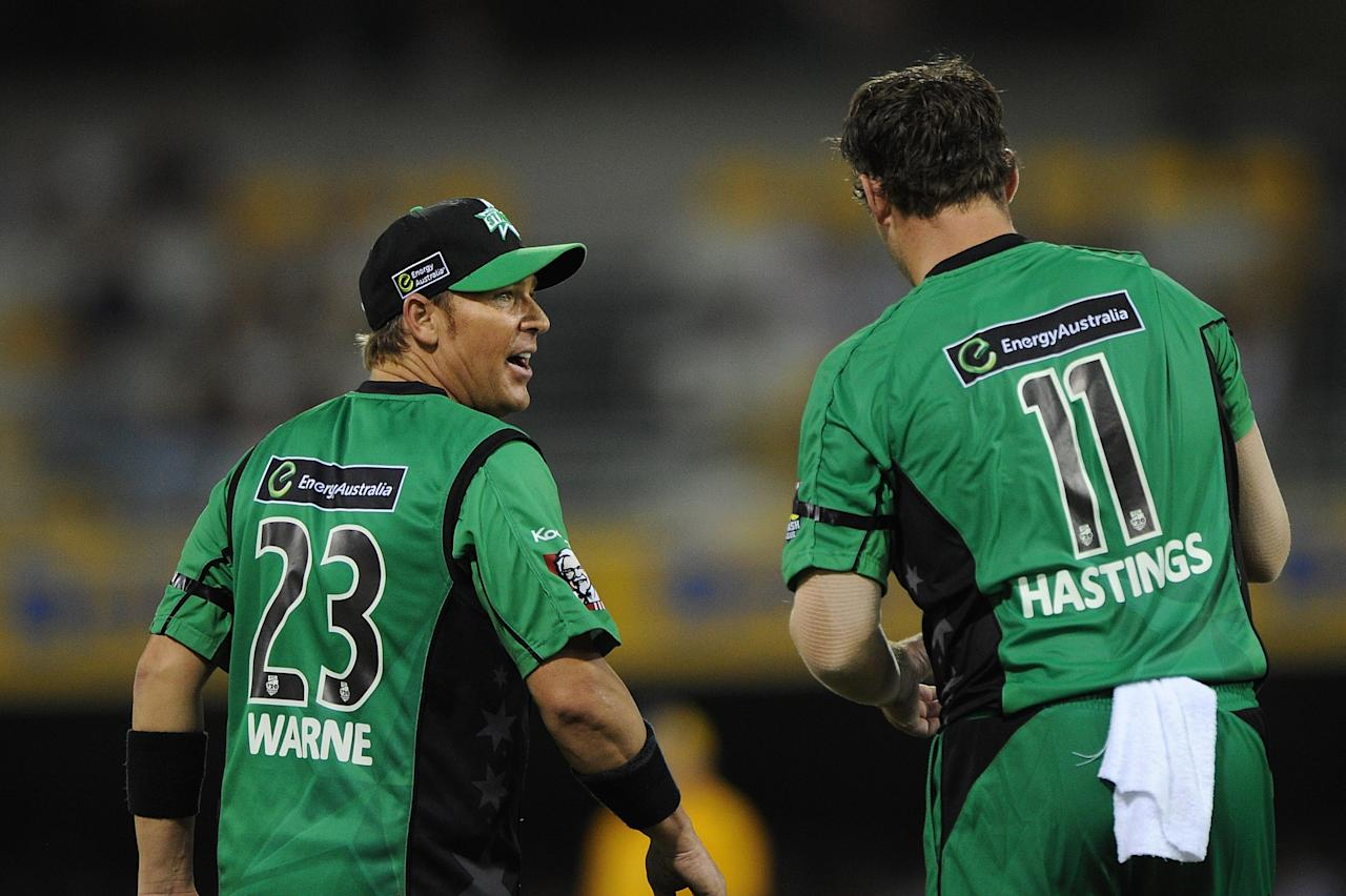 BRISBANE, AUSTRALIA - JANUARY 03:  Shane Warne speaks with John Hastings of the Stars during the Big Bash League match between the Brisbane Heat and the Melbourne Stars at The Gabba on January 3, 2013 in Brisbane, Australia.  (Photo by Matt Roberts/Getty Images)