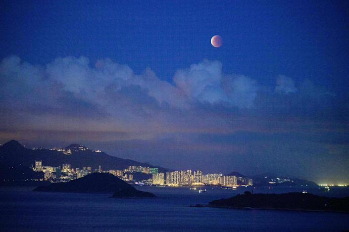 The moon was photographed over Hong Kong on May 26, 2021 during a total lunar eclipse / credit: ANTHONY WALLACE/AFP via Getty Images.