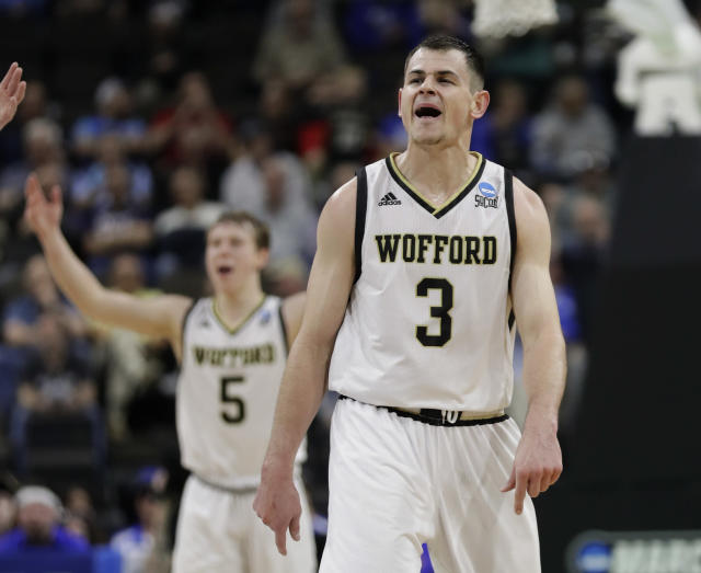 Wofford's Fletcher Magee (3) celebrates a 3-point shot against Seton Hall with teammate Storm Murphy (5) during the second half of a first-round game in the NCAA mens college basketball tournament in Jacksonville, Fla., Thursday, March 21, 2019. (AP Photo/John Raoux)