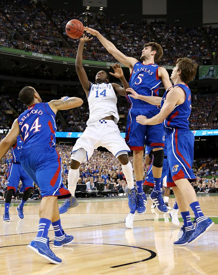 Jeff Withey #5 of the Kansas Jayhawks blocks a shot from Michael Kidd-Gilchrist #14 of the Kentucky Wildcats in the National Championship Game of the 2012 NCAA Division I Men's Basketball Tournament at the Mercedes-Benz Superdome on April 2, 2012 in New Orleans, Louisiana. (Photo by Ronald Martinez/Getty Images)