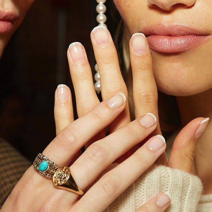 """<p>More proof the <a href=""""http://www.instyle.com/beauty/nails/french-manicure-trend"""">French manicure</a> is back: Khaite's classic white tips. Manicurist Betina Goldstein kept the look clean and simple with Essie's sheer pink <a href=""""https://ulta.7eer.net/c/249354/164999/3037?subId1=IS%2CNYFWManicures%2Clukase%2C%2CIMA%2C3478022%2C201909%2CI&u=https%3A%2F%2Fwww.ulta.com%2Fnail-polish%3FproductId%3DxlsImpprod1320170"""" target=""""_blank"""">Mademoiselle</a> for the base and full-coverage white Blanc for the pencil-thin tips. </p>"""