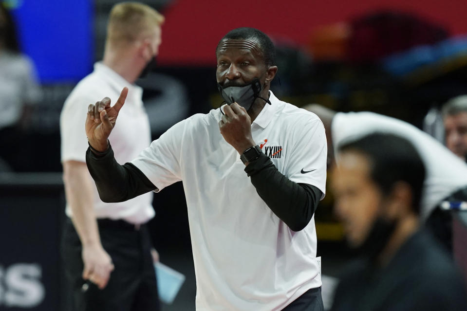 Detroit Pistons head coach Dwane Casey directs from the sideline during the first half of an NBA basketball game against the Miami Heat, Sunday, May 16, 2021, in Detroit. (AP Photo/Carlos Osorio)