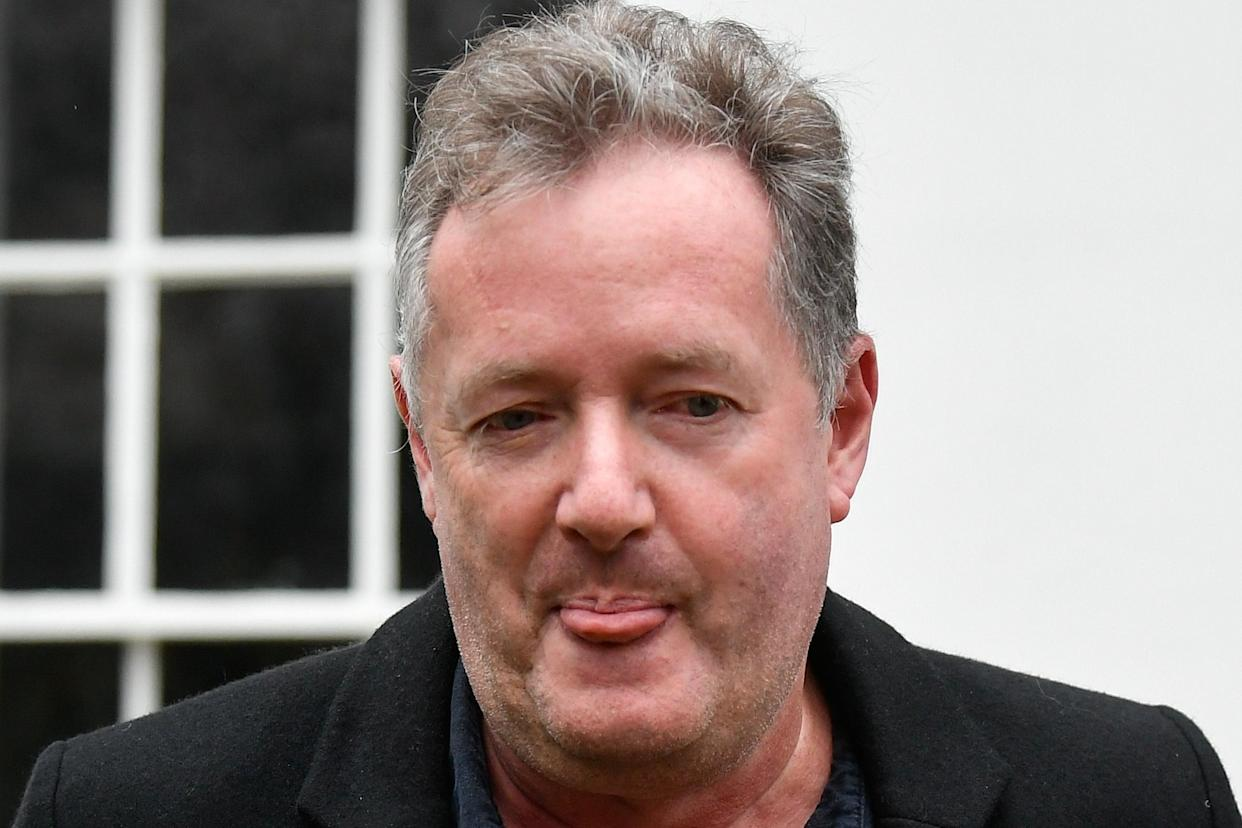 Journalist and television presenter Piers Morgan reacts as he takes his daughter Elise to school, after he left his high-profile breakfast slot with the broadcaster ITV, following his long-running criticism of Prince Harry's wife Meghan, in London, Britain, March 10, 2021. REUTERS/Toby Melville