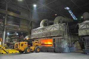 An operator at Arconic's Tennessee operations uses a skim truck to remove impurities from the molten metal for efficiency in the recycling process.