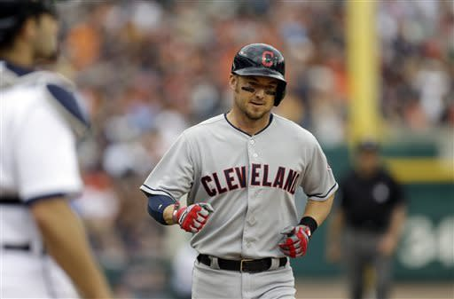 Cleveland Indians' Ryan Raburn arrives a home plate after his solo home run during the fifth inning of a baseball game against the Detroit Tigers in Detroit, Sunday, June 9, 2013. (AP Photo/Carlos Osorio)