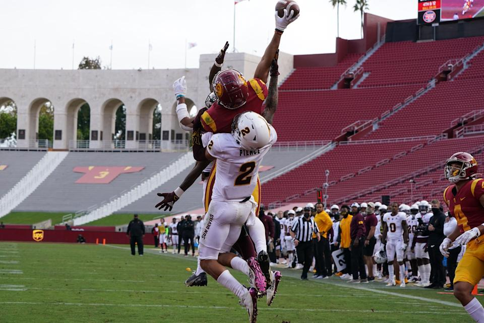 Nov 7, 2020; Los Angeles CA, USA; Southern California Trojans wide receiver Amon-Ra St. Brown (8) makes a catch while defended by Arizona State Sun Devils defensive back DeAndre Pierce (2) in the fourth quarter at the Los Angeles Memorial Coliseum. USC defeated Arizona State 28-27.  Mandatory Credit: Kirby Lee-USA TODAY Sports