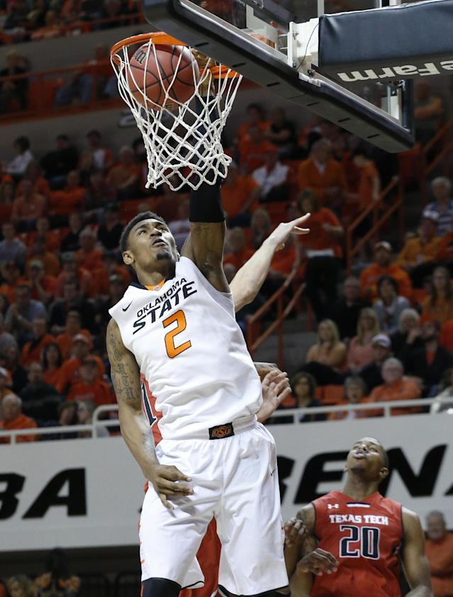 Oklahoma State wing Le'Bryan Nash (2) dunks in front of Texas Tech guard Toddrick Gotcher (20) during the second half of an NCAA college basketball game in Stillwater, Okla., Saturday, Feb. 22, 2014. Oklahoma State won 84-62. (AP Photo/Sue Ogrocki)