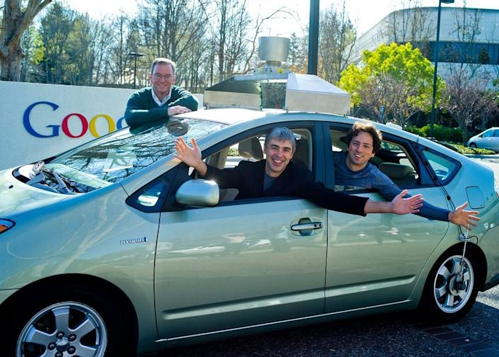 Former Google executive chairman Eric Schmidt (left) pictured with cofounders Larry Page (center) and Sergey Brin (right).