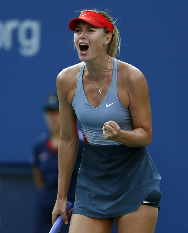 Maria Sharapova, of Russia, reacts after a point against Alexandra Dulgheru, of Romania, during the second round of the 2014 U.S. Open tennis tournament, Wednesday, Aug. 27, 2014, in New York. (AP Photo/Matt Rourke)