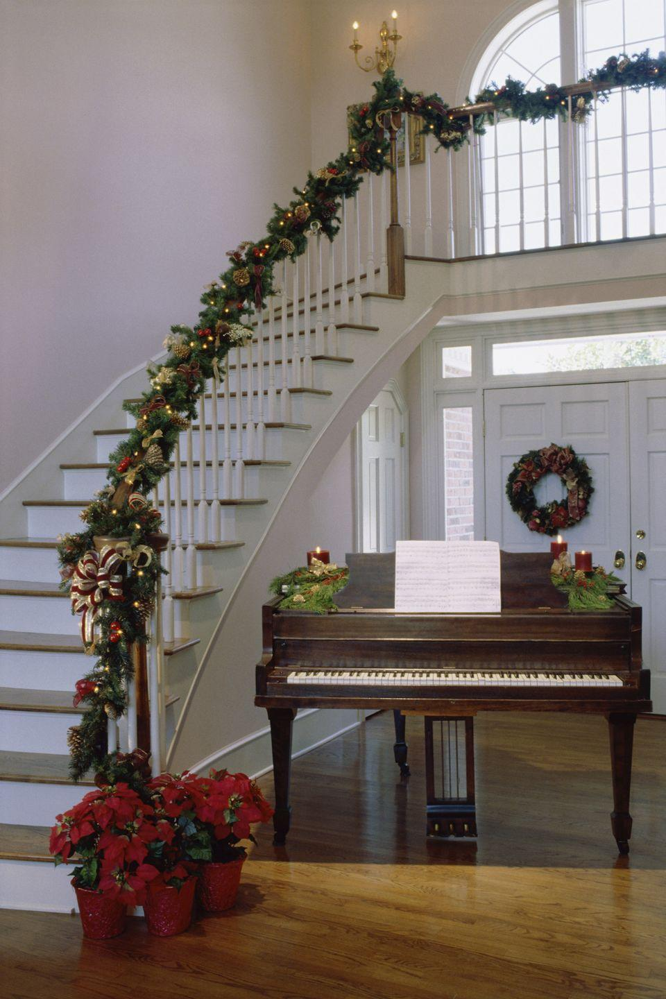 <p>Opt for a garland that has Christmas lights weaved into it, filling the room with a traditional holiday ambience.</p>