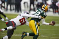 Tampa Bay Buccaneers' Shaquil Barrett sacks Green Bay Packers quarterback Aaron Rodgers during the first half of the NFC championship NFL football game in Green Bay, Wis., Sunday, Jan. 24, 2021. (AP Photo/Matt Ludtke)