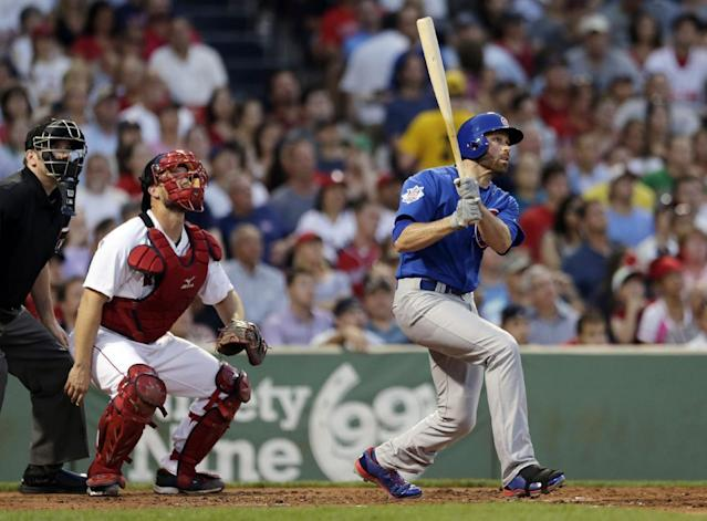 Chicago Cubs' Nate Schierholtz, right, watches the flight of his two-run, home run off Boston Red Sox starting pitcher Jake Peavy during the fourth inning of a baseball game at Fenway Park in Boston, Monday, June 30, 2014. At left is Boston Red Sox catcher David Ross. (AP Photo/Charles Krupa)