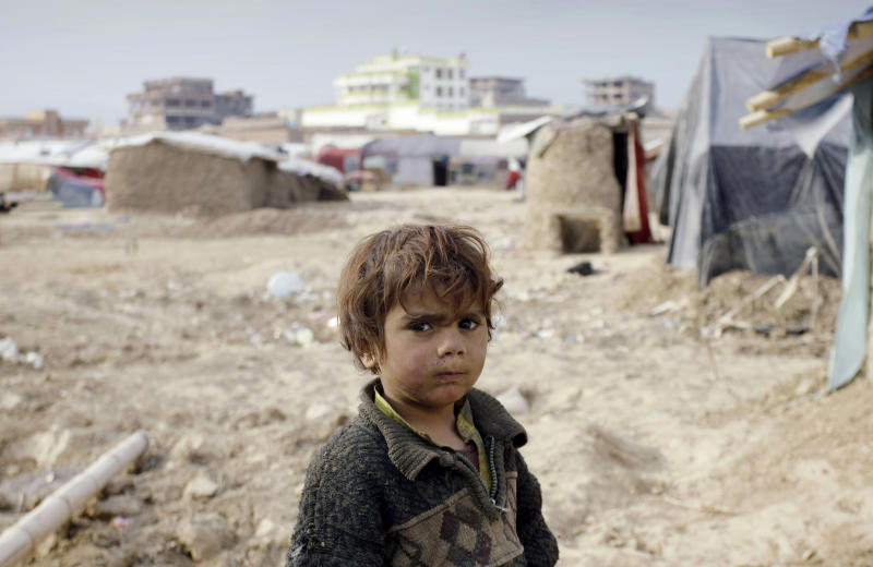 An internally displaced Afghan child stands at a refugee camp on the outskirts of Kabul, Afghanistan, Wednesday, Dec. 12, 2012. More than 2 million Afghans are at risk from cold, disease and malnutrition this winter as an international appeal for funds to help one of the world's poorest countries has fallen drastically short of its goal, the United Nations and several humanitarian agencies warned on Wednesday. (AP Photo/Musadeq Sadeq)
