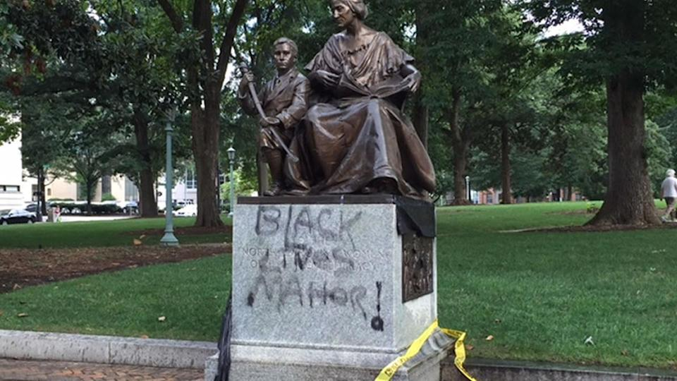 "In 2015, the monument to North Carolina Women of the Confederacy was spray painted with ""Black Lives Matter!"". (Photo:  <span class=""asset-item-link""><span class=""asset-item-author"">WTVD – Raleigh/Durham)</span></span>"