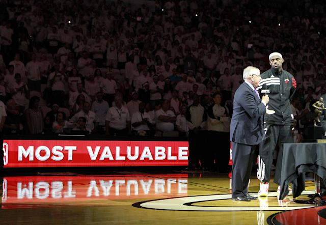 MIAMI, FL - MAY 13: Forward Lebron James #6 of the Miami Heat receives the Most Valuable Player Trophy from Commissioner of the NBA David Stern prior to playing against the Indiana Pacers in Game One of the Eastern Conference Semifinals in the 2012 NBA Playoffs on May 13, 2012 at the American Airines Arena in Miami, Florida. The Heat defeated the Pacers 95-86. NOTE TO USER: User expressly acknowledges and agrees that, by downloading and or using this photograph, User is consenting to the terms and conditions of the Getty Images License Agreement. (Photo by Marc Serota/Getty Images)