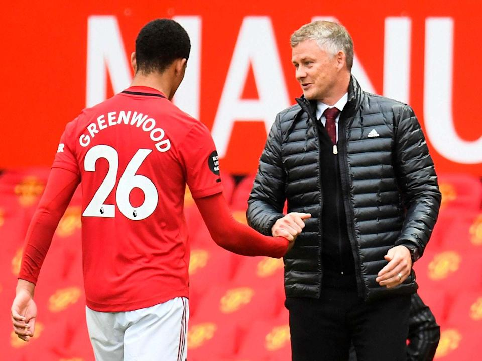Mason Greenwood is congratulated by Manchester United manager Ole Gunnar Solskjaer: Getty