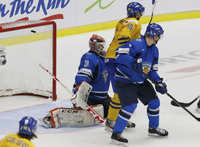 Finland's goalie Juuse Saros lets in a goal by Sweden's Christian Djoos, not seen, during the third period of their IIHF World Junior Championship ice hockey game in Malmo, Sweden, January 5, 2014. REUTERS/Alexander Demianchuk (SWEDEN - Tags: SPORT ICE HOCKEY)