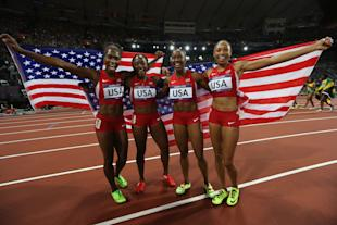 Carmelita Jeter, Bianca Knight, Allyson Felix, and Tianna Madison celebrate after winning the Women's 4 x 100m Relay Final (Getty Images)