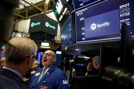 A price update is given on shares of Spotify before the company's direct listing on the floor of the New York Stock Exchange in New York, U.S., April 3, 2018.  REUTERS/Lucas Jackson