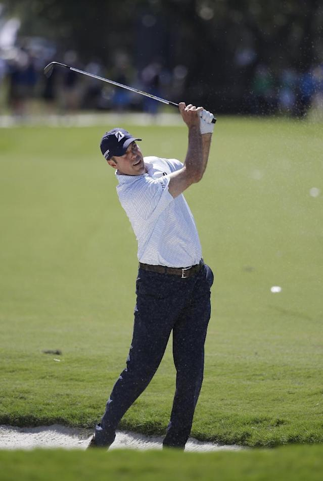Matt Kuchar hits from the fifth fairway during the second round of the Cadillac Championship golf tournament on Friday, March 7, 2014, in Doral, Fla. (AP Photo/Lynne Sladky)