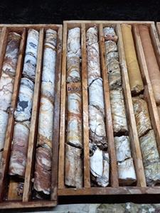 Complex silica textures and structures in a somewhat banded silica alteration zone, drill hole NP-21-04, drill core diameter 6.4 cm.