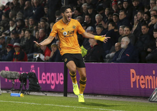 Wolverhampton Wanderers' Raul Jimenez celebrates scoring his side's second goal of the game during the English Premier League soccer match between Bournemouth and Wolverhampton Wanderers, at the Vitality Stadium, in Bournemouth, England, Saturday, Nov. 23, 2019. (Mark Kerton/PA via AP)