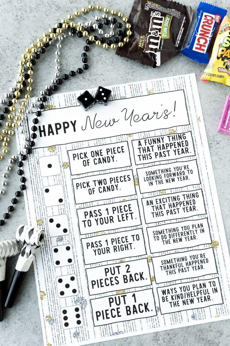 "<p>All you need to play this game is a single die, a bag of candy, and this free printable. Roll the die and grab or give up candies based on what number you land on — plus, follow the prompt to reflect on the past year. It's a friendly competition as well as an exercise in gratitude. </p><p><em><a href=""https://www.playpartyplan.com/new-years-eve-dice-game/"" rel=""nofollow noopener"" target=""_blank"" data-ylk=""slk:Get the idea at Play Party Plan »"" class=""link rapid-noclick-resp"">Get the idea at Play Party Plan »</a></em><br></p>"