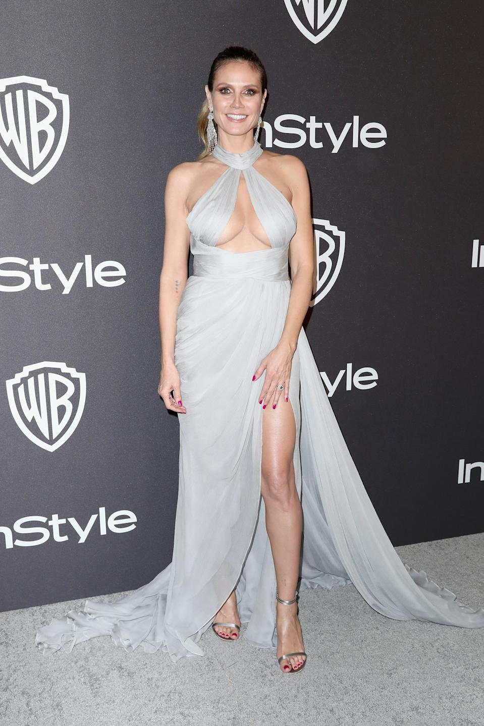 <p>Wearing a Paolo Sebastian dress, Giuseppe Zanotti shoes, Lorraine Schwartz jewellery and a Judith Leiber clutch. <em>[Photo: Getty]</em> </p>