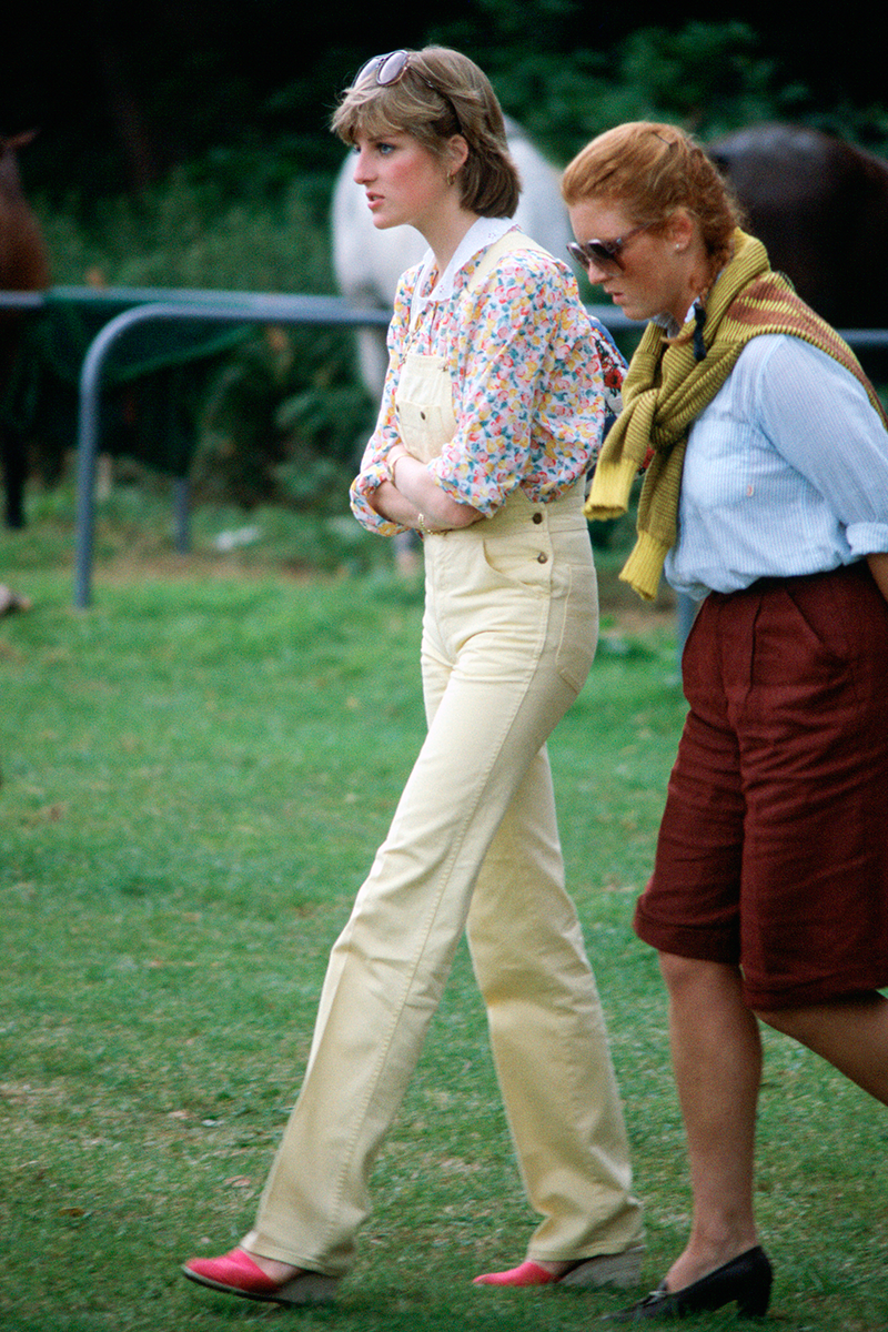 "<p>Putting her own spin on the dungarees trend, Di wore this lemon yellow iteration over a technicolour collared blouse for a trip to the polo. Extra style points for the statement wedges (perfect for talking across the lawns) and the oversized shades perched atop of her head. If you think it looks familiar, it was one of the many Diana looks recreated in <a href=""https://www.cosmopolitan.com/uk/fashion/celebrity/g34700006/emma-corrin-the-crown-princess-diana-fashion/"" rel=""nofollow noopener"" target=""_blank"" data-ylk=""slk:The Crown"" class=""link rapid-noclick-resp"">The Crown</a>.</p>"