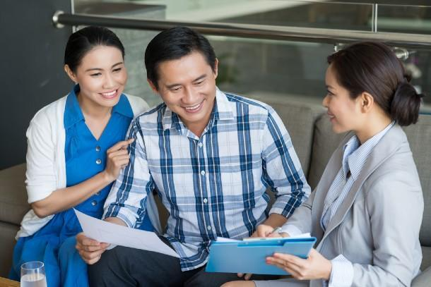 A property agent explaining an Option to Purchase agreement to a couple