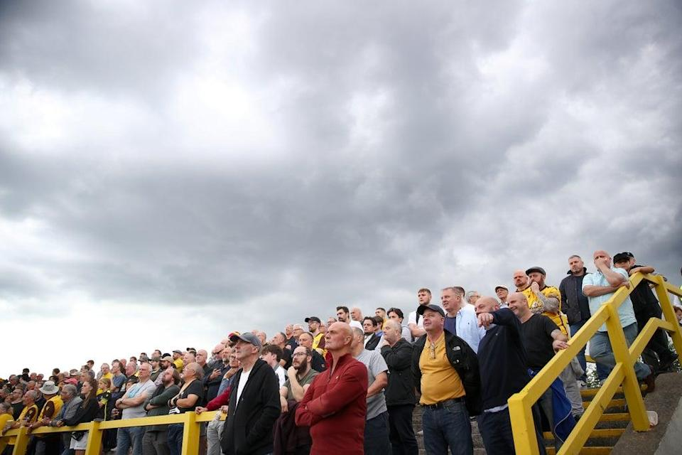 Fans on the terraces during the Sky Bet League Two match between Sutton United and Oldham Athletic (Getty Images)