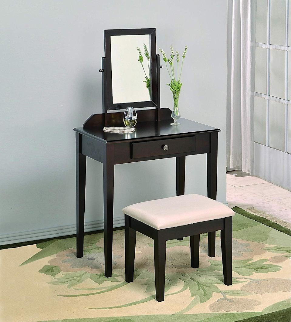 <p>This mini <span>Crown Mark Iris Vanity Table</span> ($110) is great for small spaces. It has a sleek yet classic and timeless look.</p>