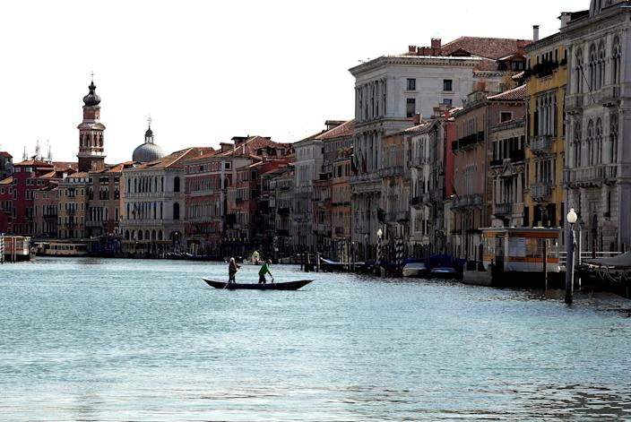 Image: A deserted canal in Venice on  on April 5, 2021. (Andrea Pattaro / AFP - Getty Images)